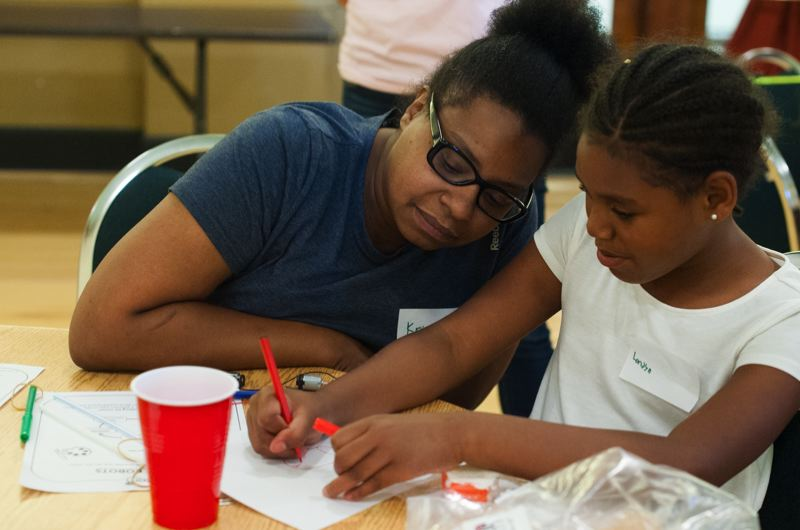 COURTESY: STEM LIKE A GIRL  - A mother and daughter work together, in a program offered by STEM Like a Girl.