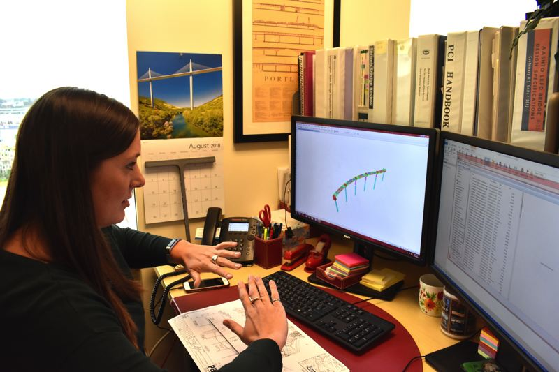 TRIBUNE PHOTO: HAILEY STEWART  - Courtney Davis, a civil project engineer who mainly works on Oregon bridges, explains the technical planning process of engineering a bridge with computer renderings and technology.