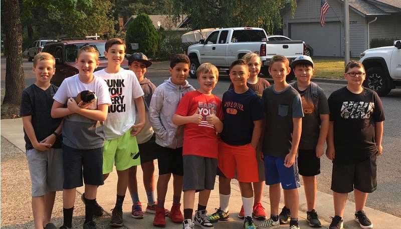 SUBMITTED PHOTO - Ben Jones (in the orange shorts) and his posse of River Grove alumni headed to Lakeridge Junior High together for the first day of sixth grade last year. Theyll be back in class for the 2018-19 school year in just a couple of weeks.