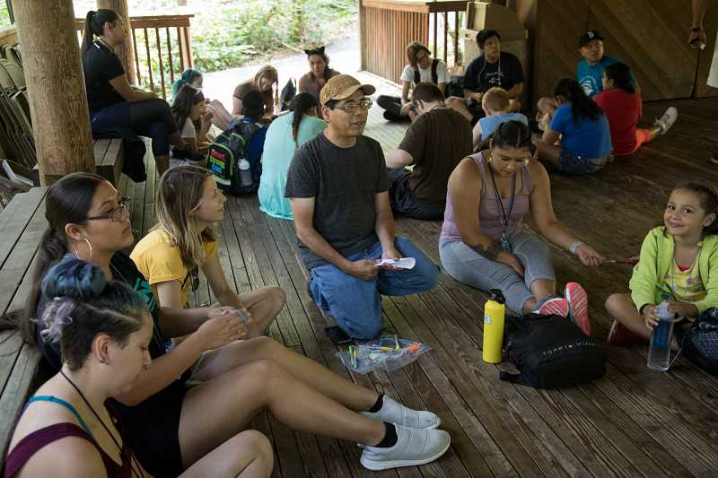 PHOTO COURTESY OF TIM LABARGE - Greg Archuleta, cultural education leader with the Confederated Tribes of the Grand Ronde, leads a lesson with a group of students from the Native American Youth and Family Center.