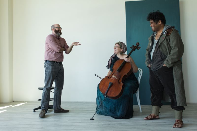 "COURTESY: GARY NORMAN - Director Patrick Walsh rehearses with Anna Fritz on cello and actor Paul Susi as they get ready to perform ""An Iliad"" in prisons across the state."