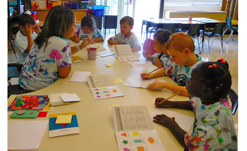 PHOTO COURTESY: LESLIE ROBINETTE - Senora Jacinta Ortiz's first-graders work on literacy skills in Spanish during the Summer Jumpstart program for Oregon City's bilingual schools — Jennings Lodge and Candy Lane elementary schools. This summer, 85 children participated.