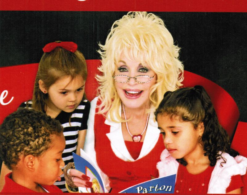 IMAGE COURTESY DOLLY PARTON IMAGINATION LIBRARY - Renowned country singer Dolly Parton reads to children to promote her Imagination Library program. The program, which relies on donations to provide new books to young children, will soon be available in Columbia County.