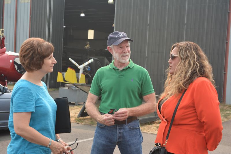 SPOTLIGHT PHOTO: COURTNEY VAUGHN - Congresswoman Suzanne Bonamici, left, gets an update on airport construction from Craig Allison (center) and Paula Miranda (right) from the Port of Columbia County.