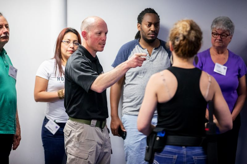 TIMES PHOTO: JONATHAN HOUSE - Beaverton Police Officer James Beane leads a Use of Force class for the Beaverton Citizens Academy.