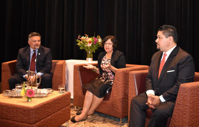 OUTLOOK PHOTO: TERESA CARSON - Danna Diaz, the new superintendent for Reynolds School District, speaks at a recent forum in Portland flanked by Portland Public Schools superintendent Guadalupe Guerrero, left, and Richard Carranza, chancellor of New York City schools.