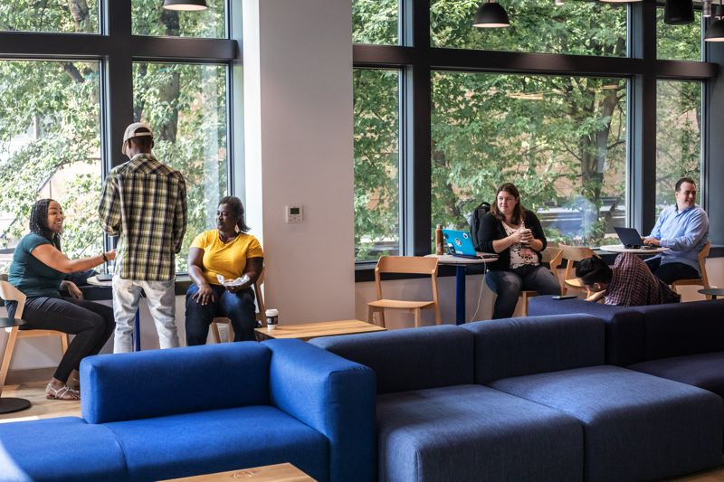 TRIBUNE PHOTO: JONATHAN HOUSE - Large windows and many types of seating on the second floor, including nooks and private rooms, will welcome people whether they are Capital One customers or not.