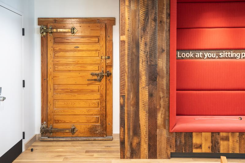 TRIBUNE PHOTO: JONATHAN HOUSE - In a bid to keep things local and historical, on the Capital One Cafe's second floor designers resused the old door of the fur cold storage room in the basement. It leads nowhee but is intended as a talking point.