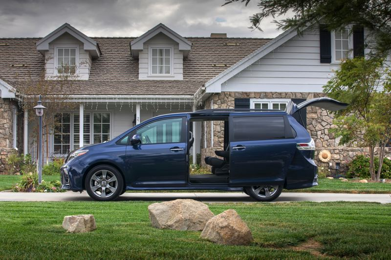 TOYOTA MOTOR CORPORATION - The sliding side doors make getting in and out of the 2018 Toyota Sienne much easier than a car or SUV, and the rear hatch opens to reveal an enormous amount of cargo space with the third row of seats folded into the floor.
