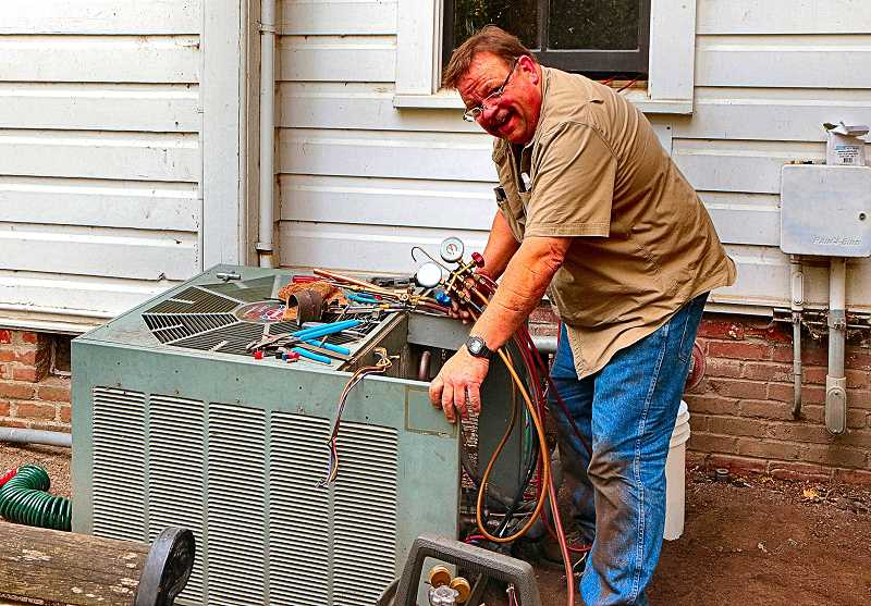 DAVID F. ASHTON - HVAC technician Ray Hughes was discouraged about the extensive damage vandals did to the air conditioning unit at historic Oaks Pioneer Church, on S.E. Spokane Street at Grand, which SMILE manages.