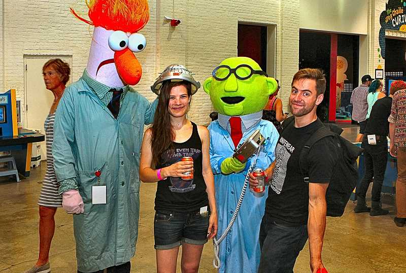 DAVID F. ASHTON - Guests Anna Sopocinski and Hunter Lea find themselves being examined by Sesame Street scientists Beaker and Dr. Bunsen Honeydew.