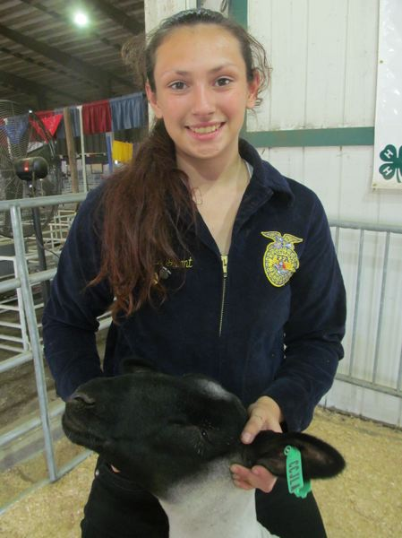 PHOTO BY DICK TRTEK - Xeira Grant, 16, is a member of the North Clackamas FFA program, where she raised Buddy, a Suffolk market lamb, this past year.