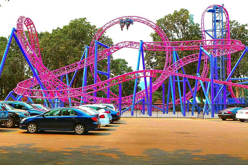 DAVID F. ASHTON - People were head over heels on National Roller Coaster Day at Oaks Amusement Park, as they took a spin on their new Adrenaline Peak roller coaster.