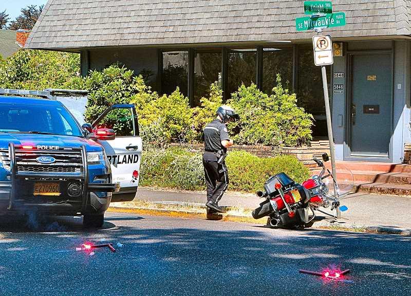 DAVID F. ASHTON - S.E. Milwaukie Avenue was closed for an hour after a motorcycle slid sideways to a stop at this Westmoreland intersection, across from Papa Haydn Restaurant.