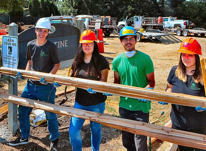 DAVID F. ASHTON - Here, a few PP&R Youth Conservation Crew members work in Hazeltine Park to build a new split rail fence.