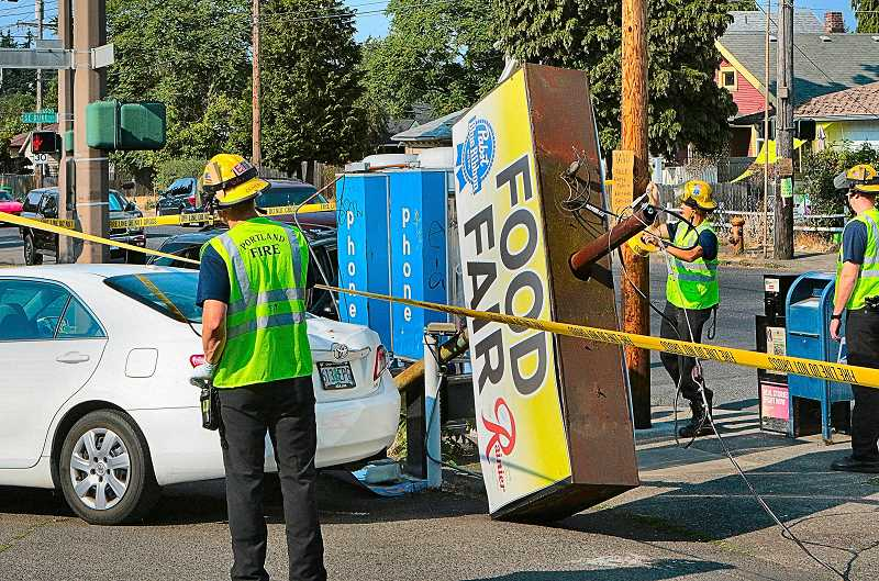 DAVID F. ASHTON - Be it cursed or simply unlucky, this intersection in Brentwood-Darlington experienced yet another accident which totaled two vehicles. One ran a red light, and then took out a nearby merchants sign.