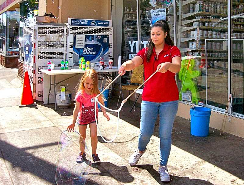 RITA A. LEONARD - At Westmoreland Ace Hardware on Milwaukie Avenue, Olivia - age 3 - was mesmerized by large bubbles made by clerk Ana Burr.