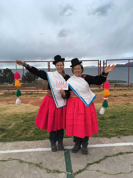 SUBMITTED PHOTO - Karen Detjens, left, and Kathleen Miller dress in traditional costumes and learn a folk dance in Peru.