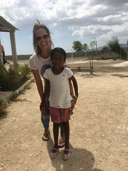 SUBMITTED PHOTO - Sarah Bradley-Culp visits an orphanage in Haiti and plays with the children.