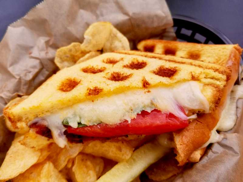 OUTLOOK PHOTO: CHRISTOPHER KEIZUR - The marks on the waffle grilled cheese at Sugarpine helps lock in the flavors.