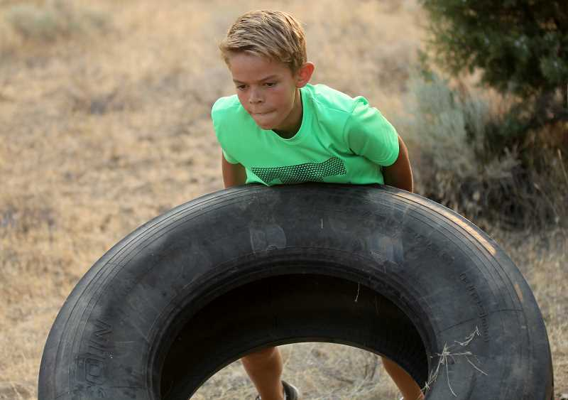 STEELE HAUGEN - Cole Rahi, 11, trains in his backyard obstacle course, getting ready for upcoming races.