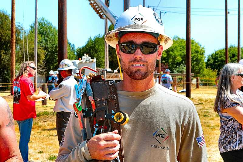 DAVID F. ASHTON - Inner-Southeast-Portland-based PGE lineman Eric Wells here takes a break from the rigors of competition at the Pacific Northwest Lineman Rodeo.
