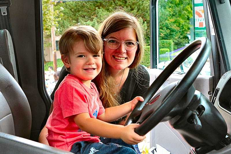 DAVID F. ASHTON - In a Security Signs lift truck cab, Katie Burns helps her little driver, Logan DiTullo, get a feel for what its like behind the wheel.
