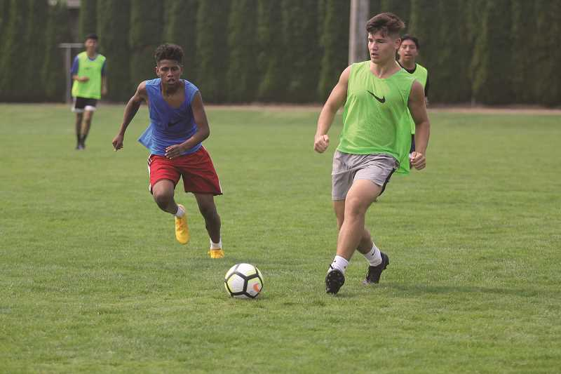 PHIL HAWKINS - Sophomore Jimmy Martin and senior Trevor Karsseboom are two of 17 members who return from last year's state championship boys soccer team.