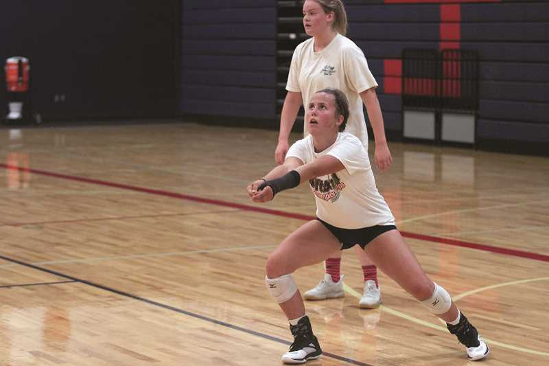 PHIL HAWKINS - Returning sophomore Hailey Arritola made an immediate impact in the Tri-River Conference in her freshman year as one of the state's best liberos. Behind, All-State senior Hailey Arritola gives Kennedy a strong hitter from the right side of the court.