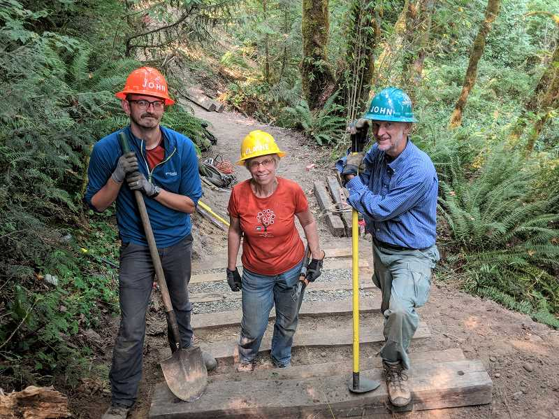 ESTACADA NEWS PHOTO: EMILY LINDSTRAND - John Hilbert, Elaine Keavney and John Sparks were part of the team working on the Maple Ridge Trail at Milo McIver State Park last week.