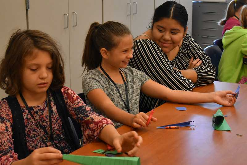 ESTACADA NEWS PHOTO: EMILY LINDSTRAND - Students work on creative projects during art class at the Estacada School District's Summer Academy Program last week.