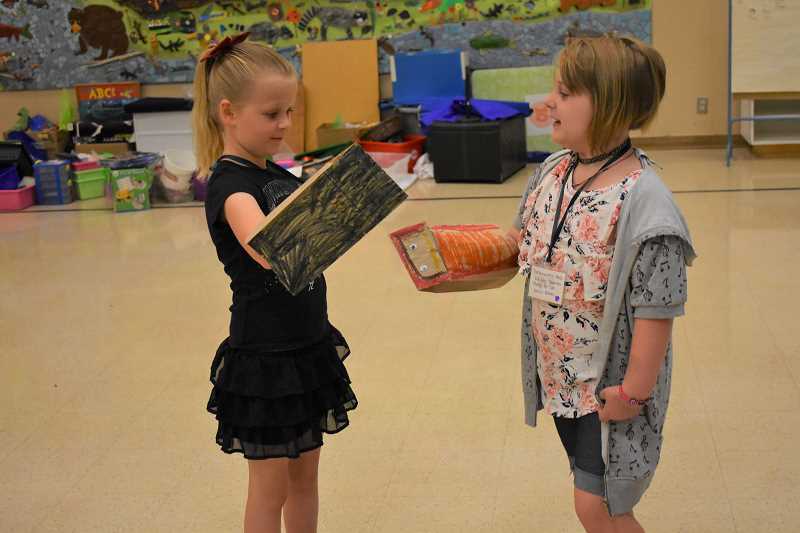 ESTACADA NEWS PHOTO: EMILY LINDSTRAND - Theater students use puppets to play the roles of the Big Bad Wolf and Little Red Riding Hood during a lesson on Friday, Aug. 17.