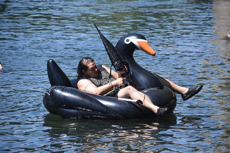 ESTACADA NEWS PHOTO: EMILY LINDSTRAND - A black swan was just one of the inflatable flotation devices used during the goth float last weekend on the Clackamas River.