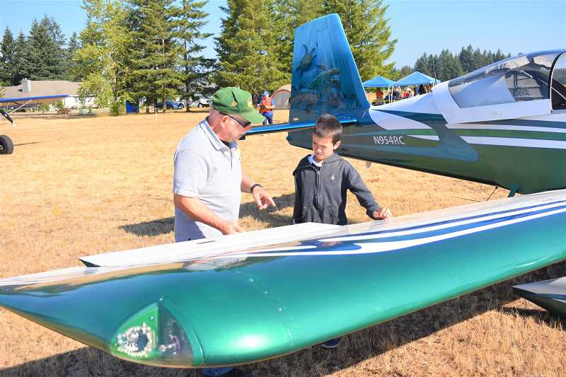 ESTACADA NEWS PHOTO: EMILY LINDSTRAND - Members of the Experimental Aircraft Association taught youths about airplane parts during an event on Saturday, Aug. 18.
