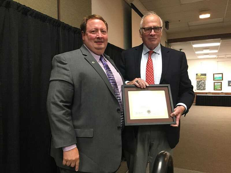 COURTESY OF JOHN COOK - Forest Grove Mayor Peter Truax, right, presents Tigard Mayor John Cook with the Oregon Mayors Association Leadership Award during the organizations annual conference last month in Florence.
