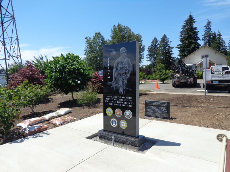 CONTRIBUTED PHOTO - The black granite Boring Vietnam Veterans Memorial stands at 7-foot high, 3-foot wide in the southern portion of the Boring Station Trailhead Park.