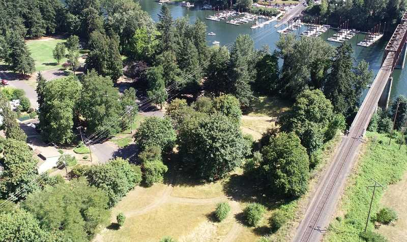 SPOKESMAN PHOTO: ALVARO FONTAN - Many things have changed about this site in Wilsonvilles century-and-a-half of history: Boones Ferry stopped operation in 1954 and the property -- once a privately held home for the ferry operator -- is owned by the city.