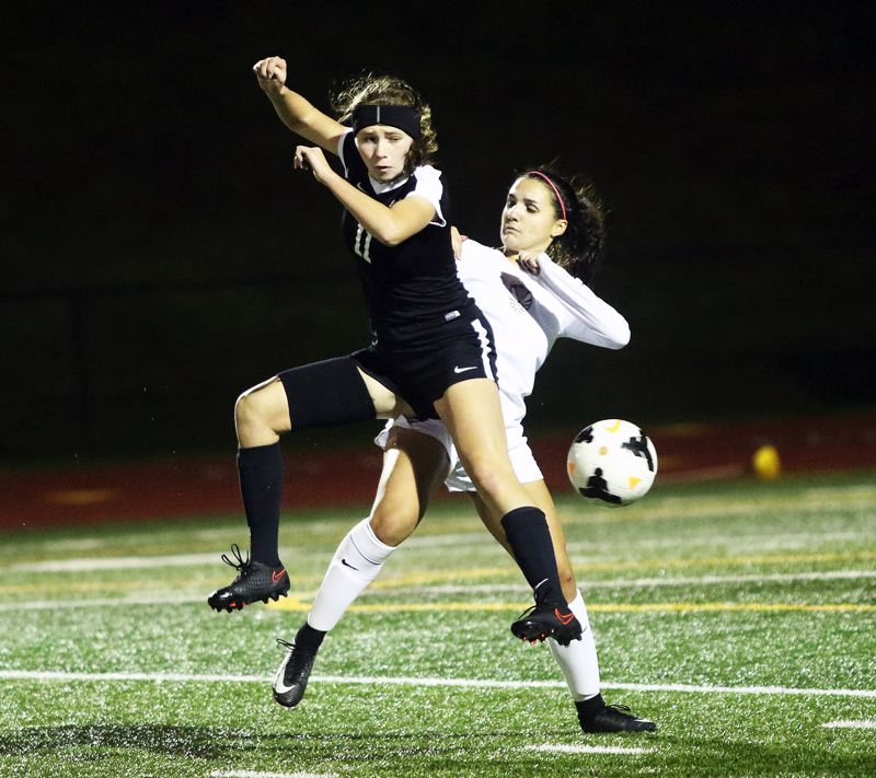 TIMES FILE PHOTO - Senior Mia Stallard (left) returns in the midfield for the Sherwood girls soccer team this season.