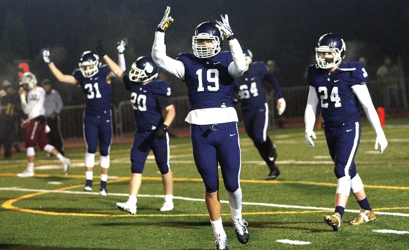 REVIEW FILE PHOTO - Lake Oswego junior defensive end Marshall McGuire and the Lakers hope to have many more reasons to celebrate in 2018 after reaching the Class 6A state semifinals in 2017.