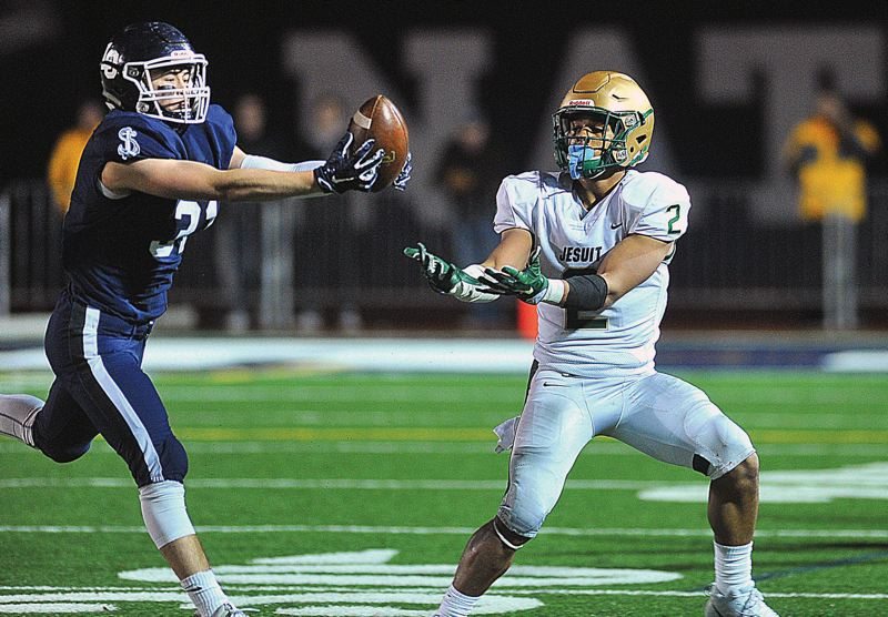 REVIEW FILE PHOTO - Lake Oswego senior linebacker Keenan DeRaeve (left) and the Laker defense expect to be a strength for the team in the coming 2018 season.