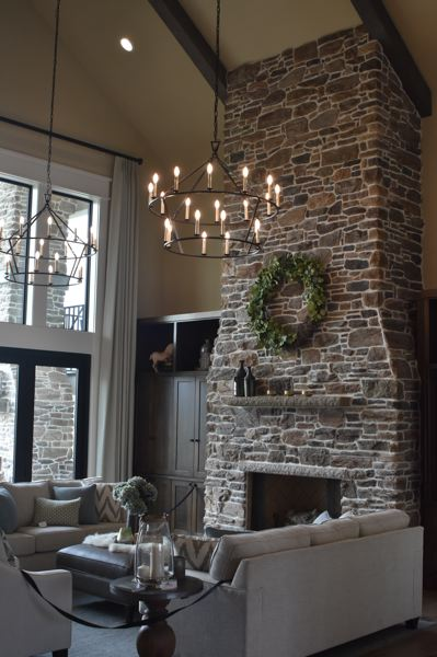PAMPLIN MEDIA GROUP: VANCE W. TONG - The Hearth & Home house features a massive stone fireplace in the main living room.
