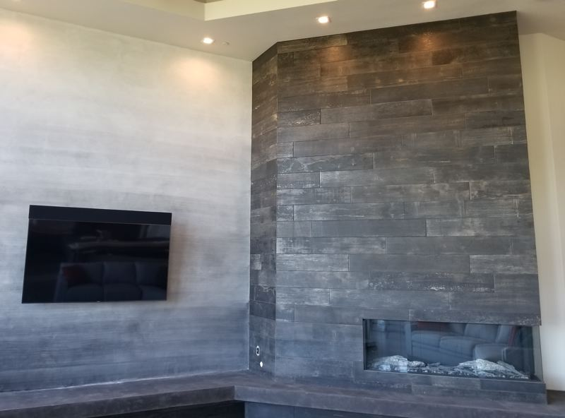 COURTESY: SCOTT BOWLES - The Montigo Prodigy indoor gas fireplace features a cool-to-the-touch glass front and a surround made of tiles designed to look like burnt cedar planks.