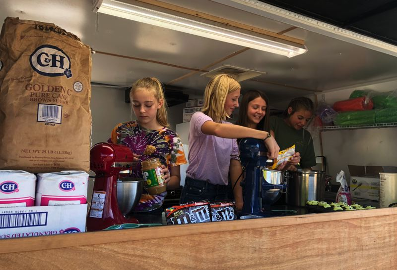 PHOTO COURTESY OF MEGAN JARMAN - The girls of Jammin Bakery whip up baked goods from a family food cart in Scappoose. Pictured left to right: Mia Hurliman, Shelby Miccham, Hadley Jarman and Megan Earl.