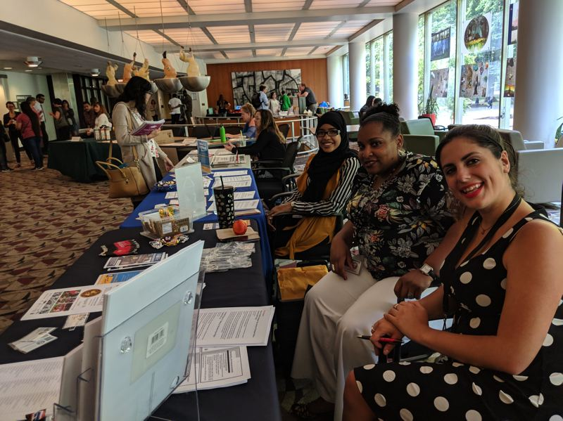 PAMPLIN MEDIA GROUP: JOSEPH GALLIVAN - (L-R) City of Portland workers Halima Abdirizak of the bureau of human resources, Shelonda Simpson a recruiter for Bureau of Development Services, and Emily Mavraganis, a recruiter for the Portland Bureau of Transportation, at a job fair for SummerWorks interns last week at Portland State University's Smith Hall. City bureaus are in hiring mode, seeking everything from asphalt rakers to city planners, but SummerWorks organizers would like it to be mandatory that public contracts go through the Connect2Careers website to give disconnected youth a shot at such jobs.