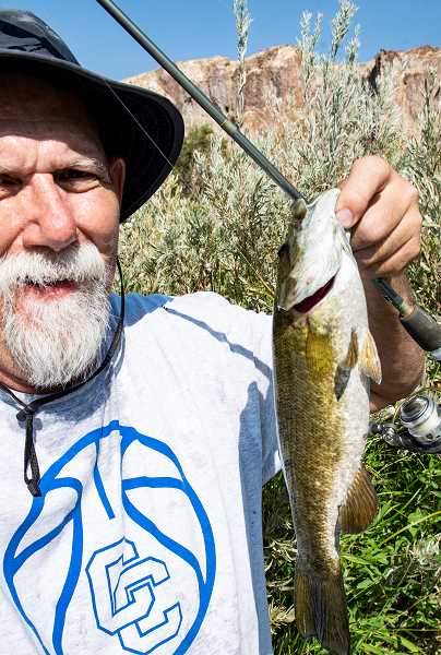 LON AUSTIN/CENTRAL OREGONIAN - The author holds a smallmouth bass he caught at Birch Creek Ranch. The ranch has several miles of river accessible to hikers.