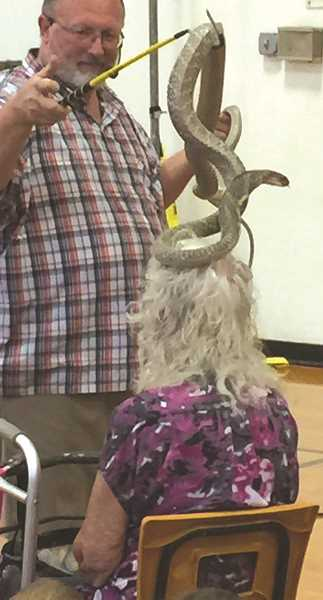 SUBMITED PHOTO: DIANA HADLEY - The Reptile Man drew a crowd of 750 people at the Molalla Public Library this summer.