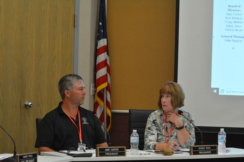 SPOTLIGHT PHOTO: COURTNEY VAUGHN - Columbia River PUD Directors Jake Carter (left) and Debbie Reed (right) mull over options for helping the city of St. Helens address a 72 percent increase in street lighting rates during a meeting Tuesday, Aug. 21.