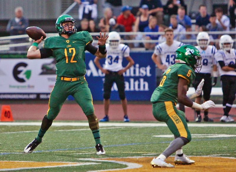 TIDINGS FILE PHOTO - West Linn senior quarterback Ethan Long returns to lead the Lions' offense after throwing for more than 3,000 yards and 32 touchdowns a year ago.