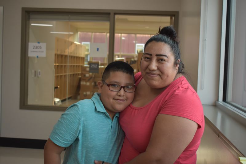 OUTLOOK PHOTO: TERESA CARSON - Wilkes Elementary School fourth-grader Angel Guzman and his mom, Alberta Hernandez, are excited about the new school, but think it will take some getting used to.
