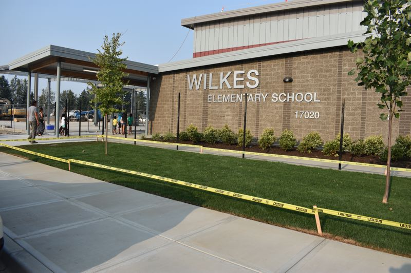 OUTLOOK PHOTO: TERESA CARSON - Wilkes Elementary School, celebrated on Tuesday, Aug. 21, will have an airy new cafeteria, a big step up from the close quarters in the basement where students used to eat.